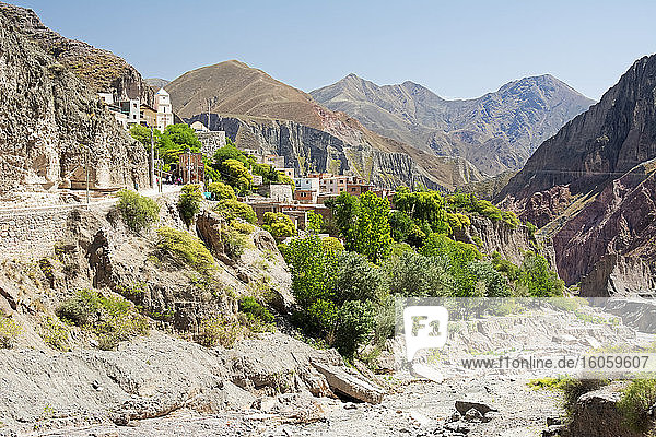 Over a dry riverbed in the mountains  a colonial Argentine village is perched precariously; Iruya  Salta  Argentina