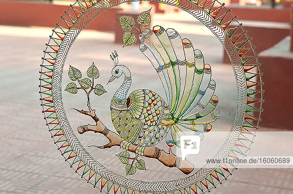 Round glass painting of a peacock  Museum of Tribal Arts and Artifacts; Bhubaneswar  Odisha  India