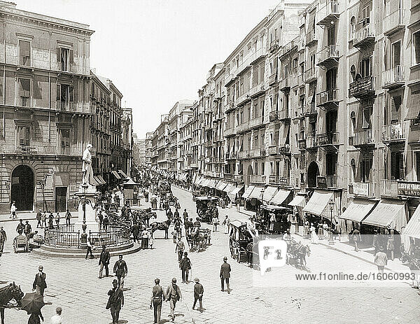 The Via Roma in Naples  Italy circa 1895. The street is now called Via Toledo. The statue on left is of Italian poet Carlo Poerio  1804 - 1867. After a work by German photographer Giorgio Sommer  1834 - 1914.