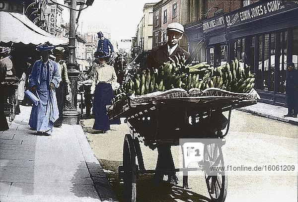 Magic lantern slide circa 1900 .Victorian/Edwardian.Social History. Slide set: a barrow boy selling fruint in the main street of Southampton