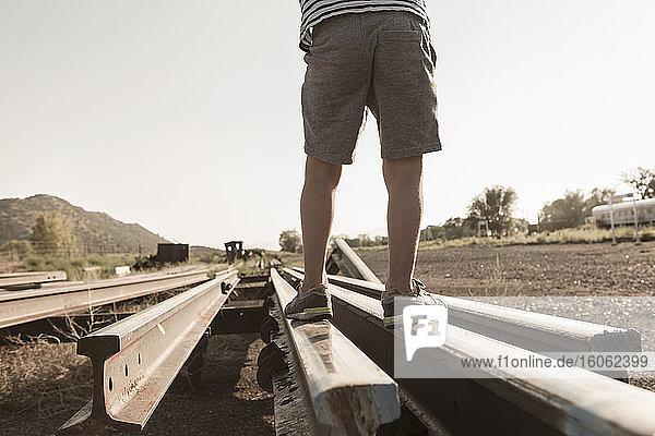 4 year old boy playing on railroad tracks Lamy NM.