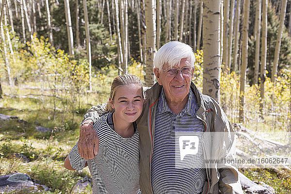 portrait of grandfather and his 11 year old grand daughter