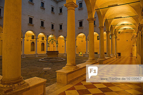 Europe  Italy  Veneto  Venice. City built on the Adriatic Sea lagoon. City of water canals instead of roads. Capital of the Serenissima Republic of Venice. UNESCO World Heritage Site. Cloister of the convent of S. Salvador