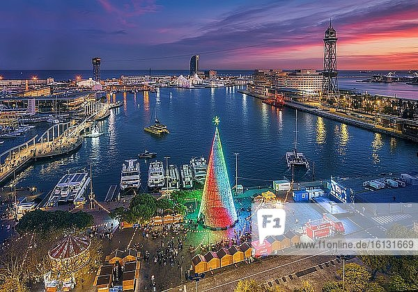 Sunset view of the Port of Barcelona and its Christmas Tree.