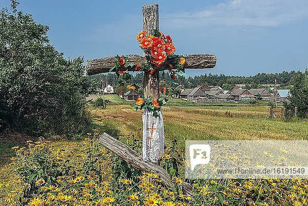 Old wayside cross in Soce village on so called The Land of Open Shutters trail  famous for traditional architecture in Podlaskie Voivodeship  Poland.