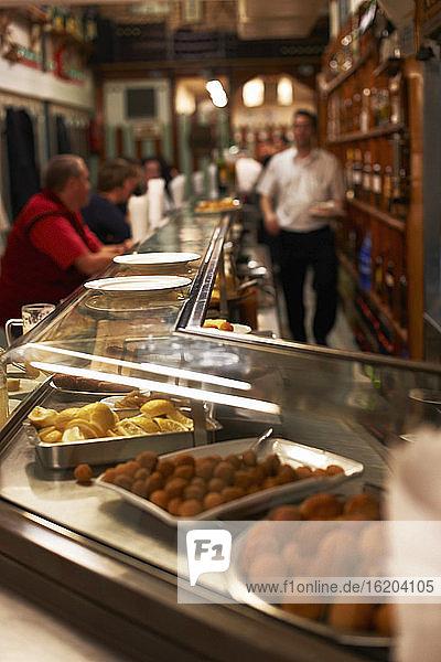 Customers in tapas bar  Barcelona  Spain