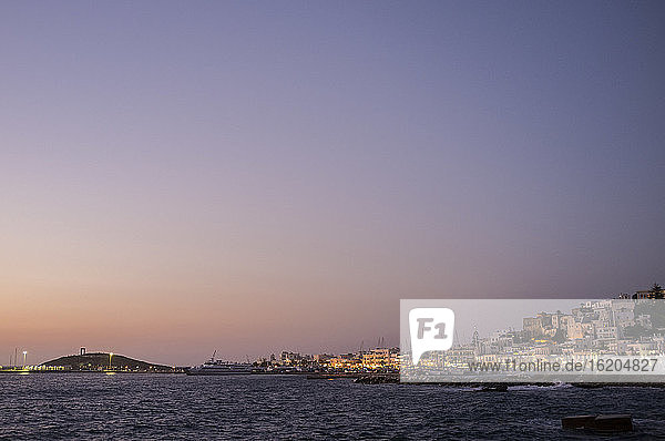 View of Naxos town waterfront at dusk  Naxos Island  Greece