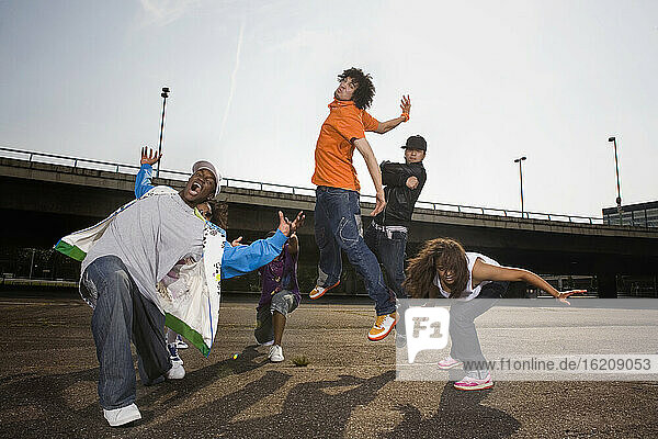 Germany  Cologne  Group of people breakdancing on street