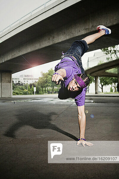 Germany  Cologne  Young man breakdancing  portrait