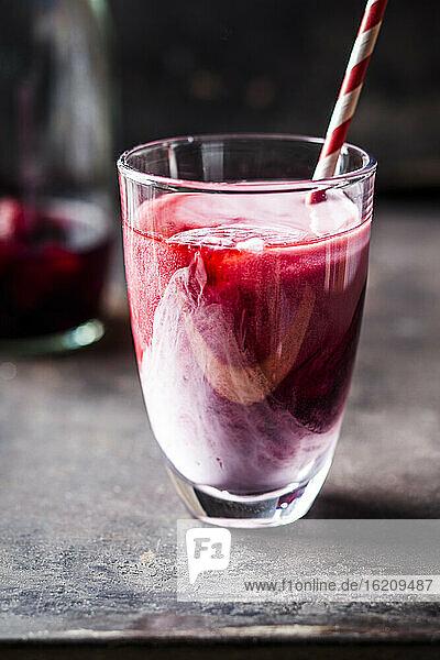 Wild berry infused black iced tea latte