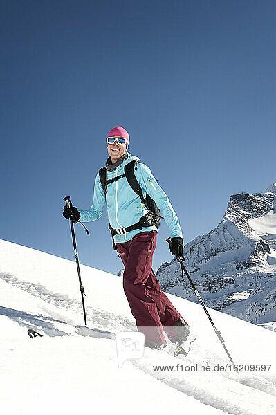 Austria  Woman skiing on mountain at Salzburger Land