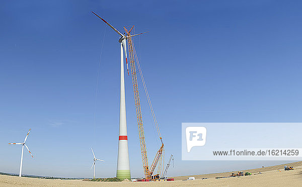 Germany  Saxony  Cnstruction of wind turbine with crane