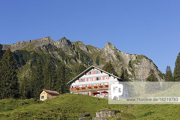 Austria  Vorarlberg  View of Alpengasthaus Edelweiss and Kilppern mountain in background