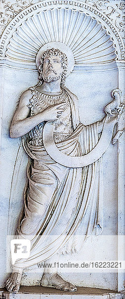Italy  Rome  Lateran quarter  Cathedral San Giovanni in Laterano  bas-relief of San Giovanni Battista Evangelista (15th century) in the cloister gallery