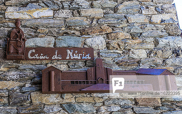 Spain  Catalonia  Pyrenees  Vall de Nuria  village of Queralbs (10th century)  Casa de Nuria (House of Nuria) plate with the sanctuary motif