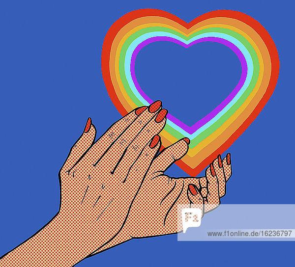 Nahaufnahme von klatschenden Händen und Regenbogenherz