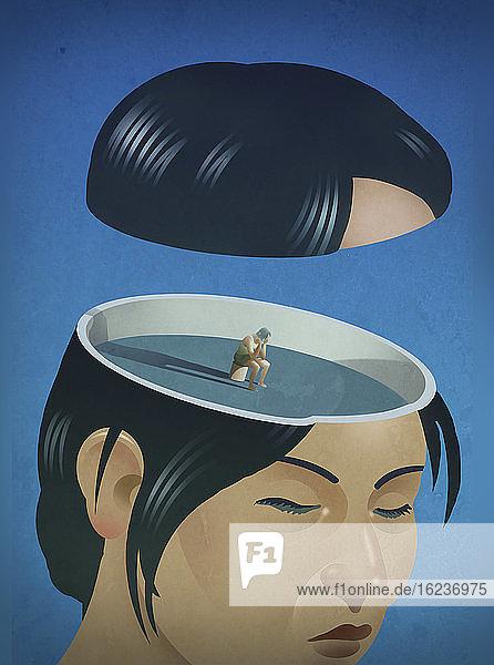 Frau sitzt verzweifelt in ihrem Kopf