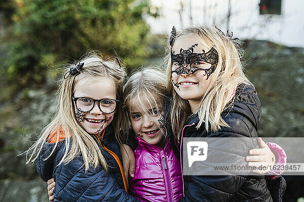 Smiling girls ready for Halloween