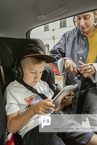 Boy in car wearing headphones