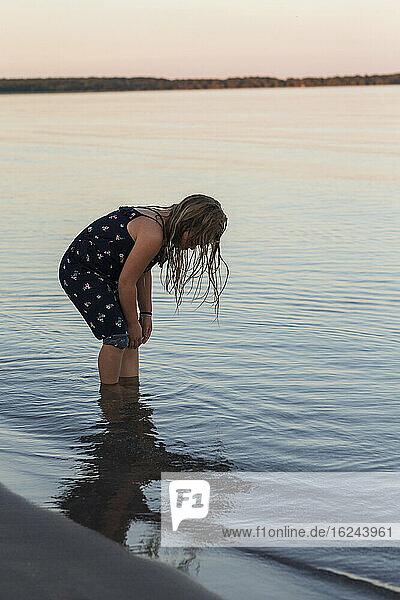 Girl standing in sea