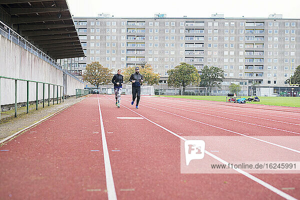 Man and woman on running track