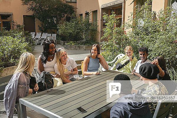 Friends sitting outside