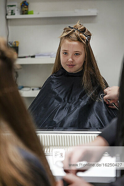 Girl having her hair cut