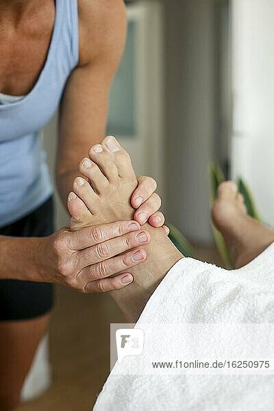 Patient having foot massage