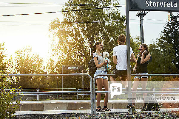 Friends on train station platform