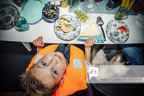 Directly above shot of boy at table