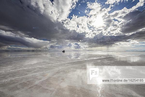 Reflection during the wet season (December-February) in Salar de Uyuni  the world's largest salt flat; Potosi Department  Bolivia