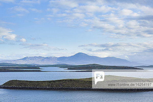 Croagh Patrick Mountain with the islands of Clew Bay on a sunny  summer day; County Mayo  Ireland