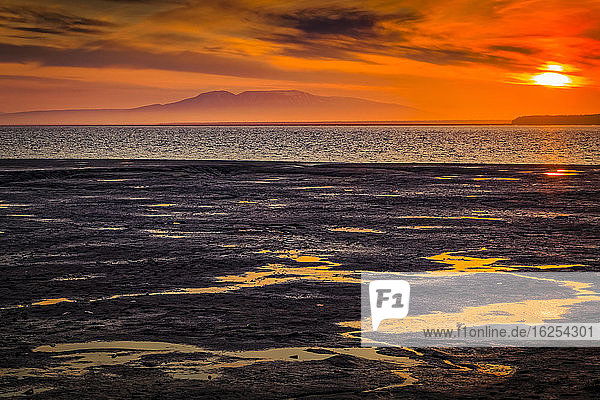 Golden sunset over Mount Susitina and Cook Inlet tidal flats  South-central Alaska; Anchorage  Alaska  United States of America