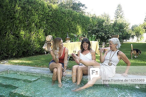 Sisters meeting in an afternoon by the pool in the country house located in the surroundings of Seville.