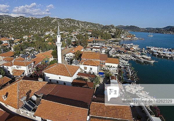 The small town of ?cagiz with harbor and mosque. From here you can take a boat to look at a sunken ancient ruined cities on the island of Kekova.