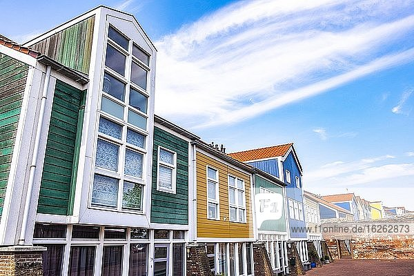 Colorful houses integrated with an old city wall in Hellevoetsluis  The Netherlands  Europe.