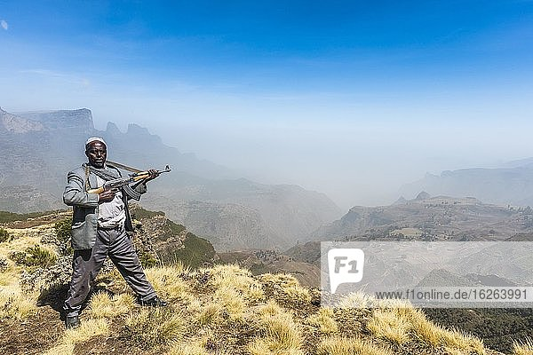 Sentry with rifle in the mountains  Simien Mountains National Park  Ethiopia  Africa