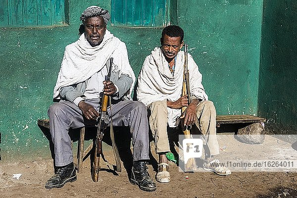 Two sentries with rifles sitting on a bench  Simien Mountains National Park  Ethiopia  Africa