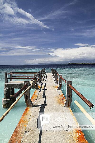 Indonesia  Lombok  Isle Gili Meno  old pier  in the background Isle Gili Air