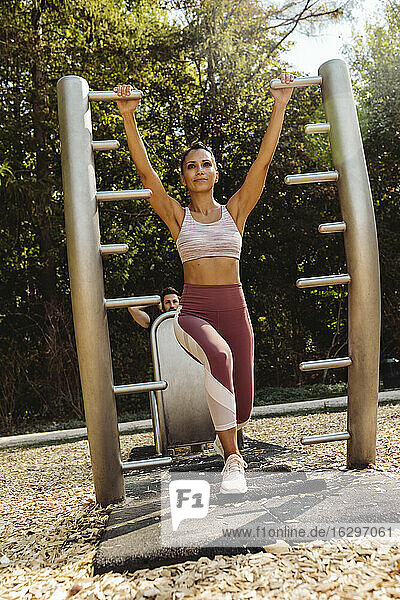 Woman stretching on a fitness trail