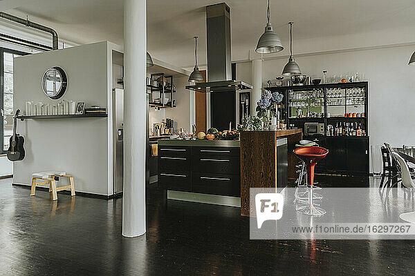 Open-plan kitchen and bar in a designer loft