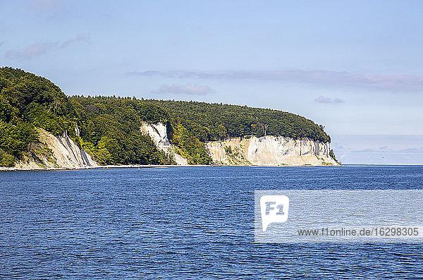Scenic view of chalk cliffs of Ruegen island on sea against sky  Germany
