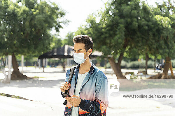 Man wearing face mask in city during COVID-19