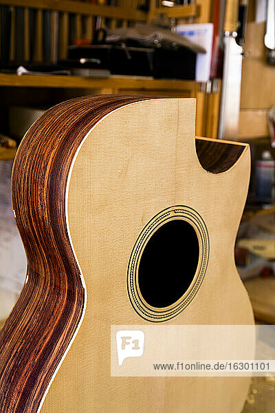 Unfinished guitar in a workshop