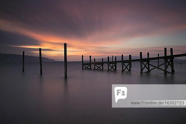 Germany  Baden-Wuerttemberg  Reichenau Island  wooden boardwalk at twilight