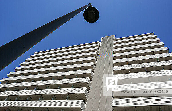 Street light in front of high rise hotel