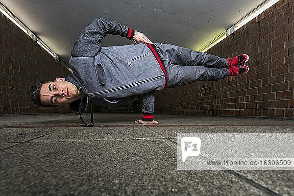 Germany  portrait of young break dancer in underpass