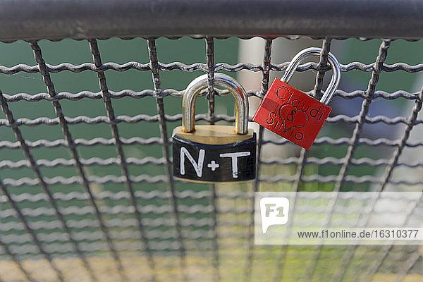 Two love locks at grid