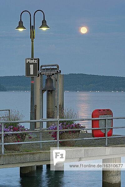 Germany  Baden-Wurttenberg  Lake Constance. full moon over harbour of Unteruhldingen