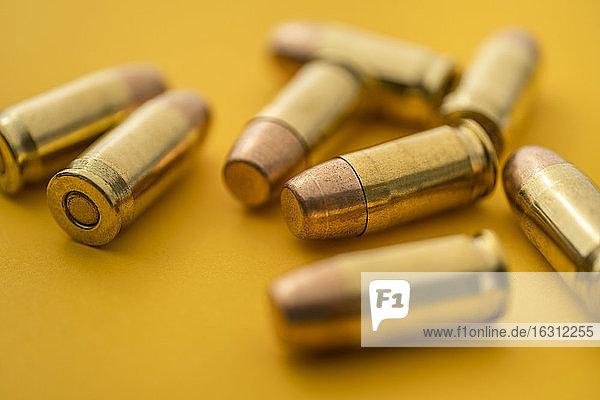 Brass bullets on yellow background